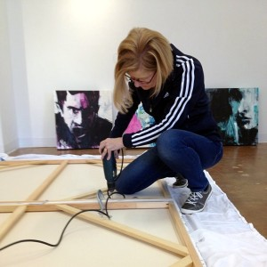 Leslie Nolan Preparing Artwork at Touchstone Gallery